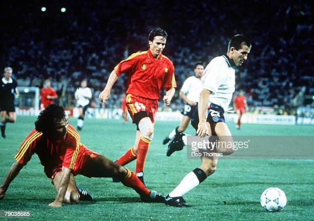 World Cup Finals Second Phase Bologna Italy 26th June England 1 v Belgium 0 England's Steve Bull beats the challenge of Belgium's Stephane De Mol