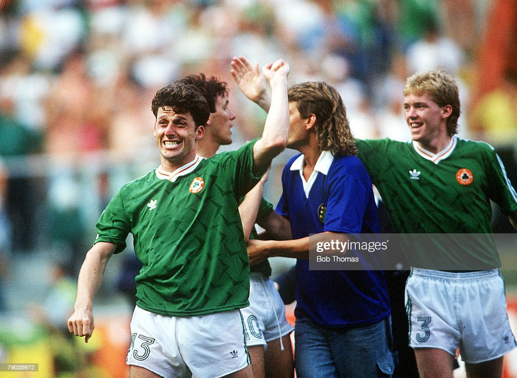 1990 World Cup Finals. Second Phase. Genoa, Italy. 25th June, 1990. Republic Of Ireland 0 v Romania 0 (Ireland win 5-4 on penalties). Republic Of Ireland's Andy Townsend (left) and Steve Staunton celebrate victory at the end. : News Photo