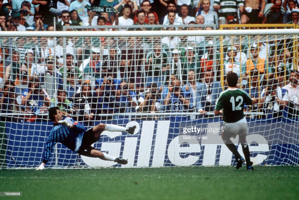1990 World Cup Finals. Second Phase. Genoa, Italy. 25th June, 1990. Republic Of Ireland 0 v Romania 0. (Republic Of Ireland win 5-4 on penalties). Republic Of Ireland's David O' Leary scores the match winning penalty past the Romanian goalkeeper. : News Photo