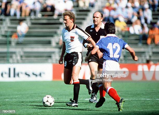 World Cup Finals Second Phase Madrid Spain 28th June France 1 v Austria 0 France's Alain Giresse moves in to challenge Austria's Herbert Prohaska