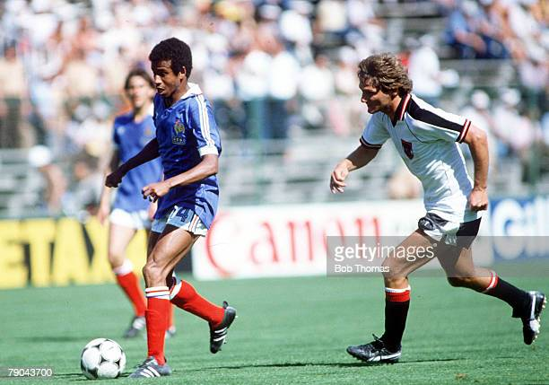 World Cup Finals Second Phase Madrid Spain 28th June France 1 v Austria 0 France's Jean Tigana is chased by Austria's Kurt Jara