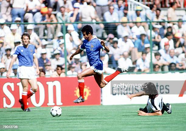 World Cup Finals Second Phase Madrid Spain 28th June France 1 v Austria 0 France's Jean Tigana jumps over the challenge of Austria's Reinhold...