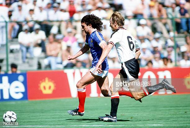 World Cup Finals Second Phase Madrid Spain 28th June France 1 v Austria 0 France's Dominique Rocheteau is chased by Austria's Roland Hattenberger