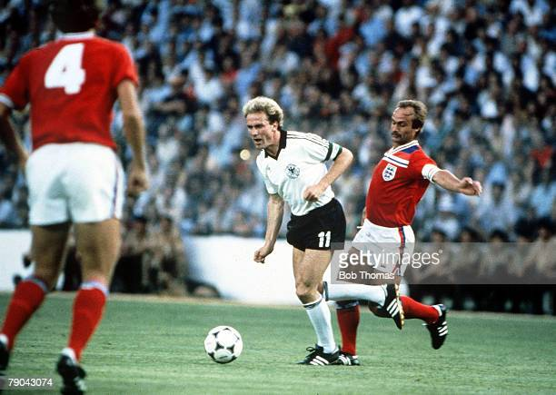 World Cup Finals Second Phase Madrid Spain 29th June England 0 v West Germany 0 England's Mick Mills chases West Germany's Karl Heinz Rummenigge for...