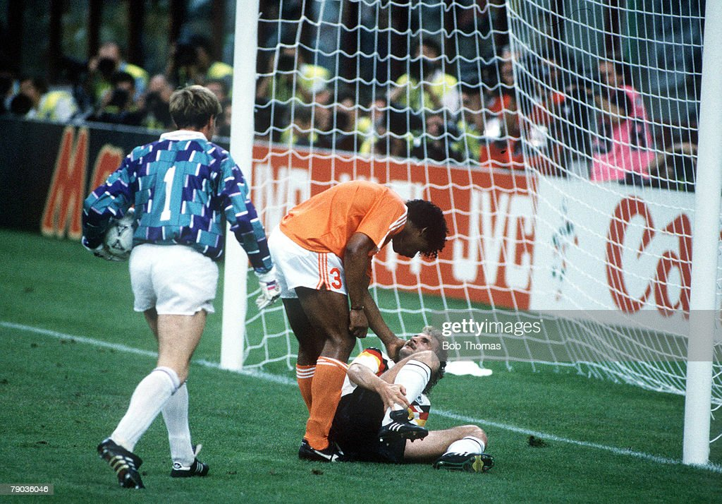 1990 World Cup Finals. Second Phase. Milan, Italy. 24th June, 1990. West Germany 2 v Holland 1. West Germany's Rudi Voeller clashes with Holland's Frank Rijkaard as Dutch goalkeeper Hans Van Breukelen looks on. Voeller and Rijkaard were later involved in  : News Photo