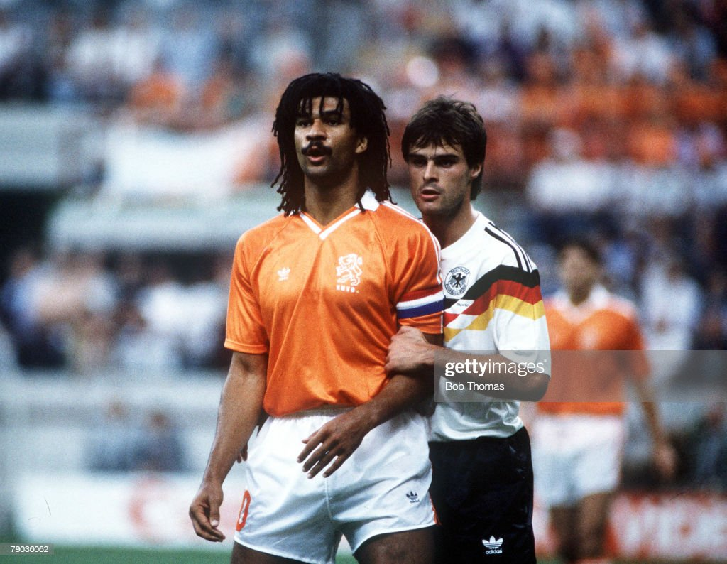 1990 World Cup Finals. Second Phase. Milan, Italy. 24th June, 1990. West Germany 2 v Holland 1. West Germany's Thomas Berthold closely marks Holland's Ruud Gullit. : News Photo