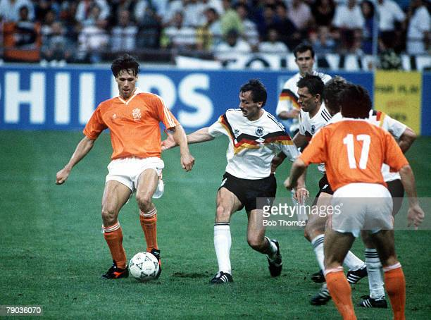 World Cup Finals Second Phase Milan Italy 24th June West Germany 2 v Holland 1 Holland's Marco Van Basten plays the ball watched by West Germany's...