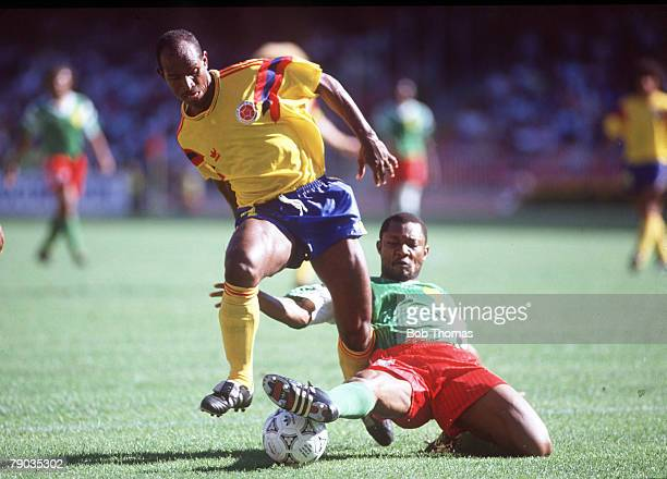 World Cup Finals Second Phase Naples Italy 23rd June Cameroon 2 v Colombia 1 Colombia's Carlos Estrada is challenged for the ball by Cameroon's Oman...