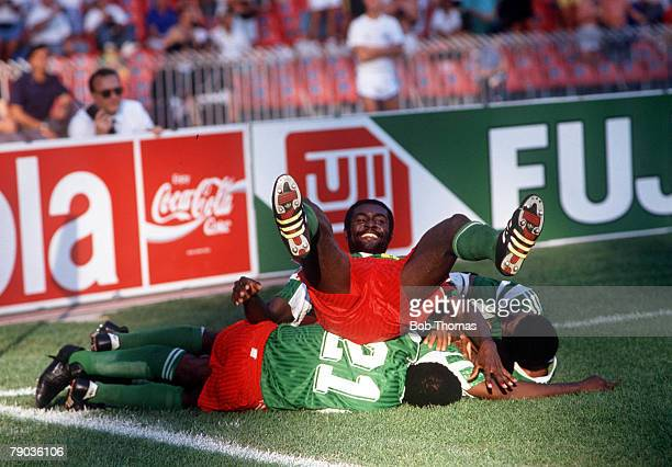 World Cup Finals Second Phase Naples Italy 23rd June Cameroon 2 v Colombia 1 Cameroon players pile on top of each other as they celebrate the winning...