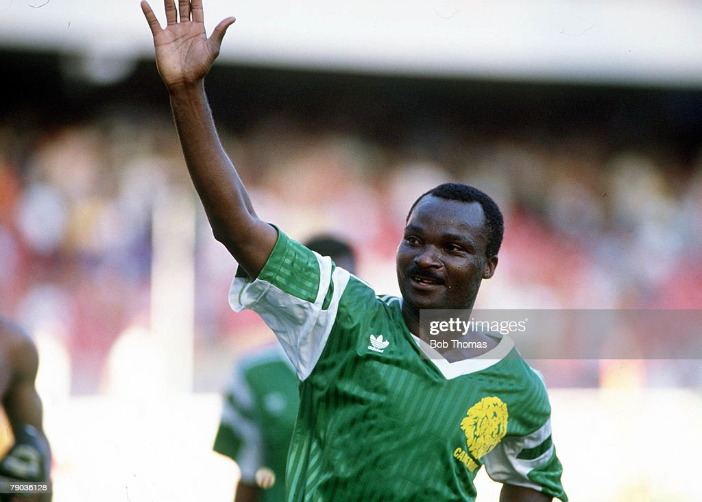 1990 World Cup Finals. Second Phase. Naples, Italy. 23rd June, 1990. Cameroon 2 v Colombia 1. Cameroon's Roger Milla waves to the crowd at the end of the match. : News Photo