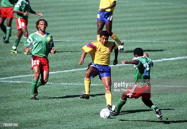 World Cup Finals Second Phase Naples Italy 23rd June Cameroon 2 v Colombia 1 Colombia's Luis Fajardo is challenged for the ball by Cameroon's Kana...