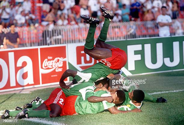 World Cup Finals Second Phase Naples Italy 23rd June Cameroon 2 v Colombia 1 Cameroon captain Stephen Tataw jumps on top of his teammates as they...