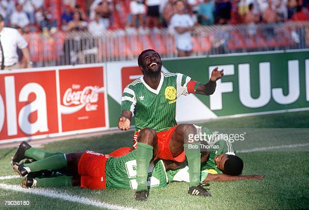 World Cup Finals Second Phase Naples Italy 23rd June Cameroon 2 v Colombia 1 Cameroon captain Stephen Tatw sits on top of his teammates as they...