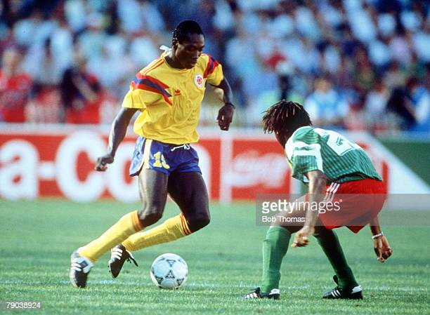 World Cup Finals Second Phase Naples Italy 23rd June Cameroon 2 v Colombia 1 Colombia's Fredy Rincon is faced by Cameroon's Cyrille Makanaky