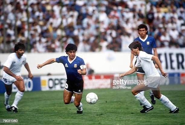 World Cup Finals Second Phase Puebla Mexico 16th June Argentina 1 v Uruguay 0 Argentina's Diego Maradona battles for the ball with Uruguay's Eduardo...