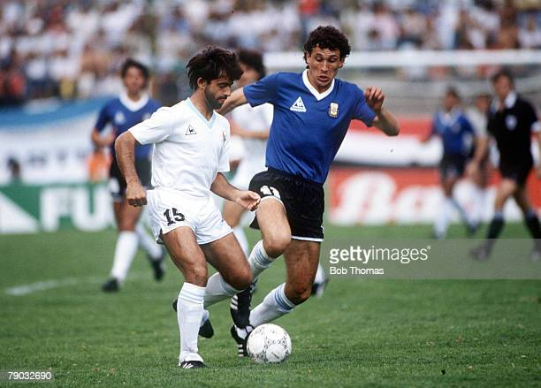 World Cup Finals Second Phase Puebla Mexico 16th June Argentina 1 v Uruguay 0 Argentina's Jorge Valdano challenges Uruguay's Rivero for the ball