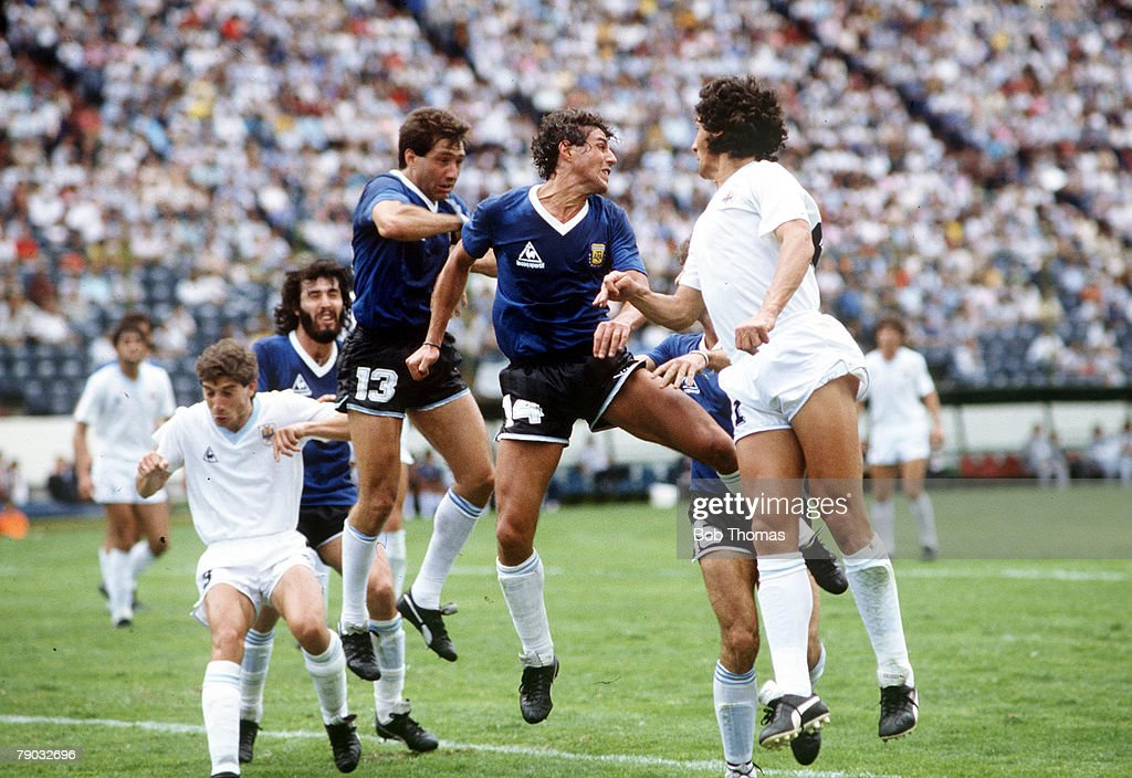 1986 World Cup Finals. Second Phase. Puebla, Mexico. 16th June, 1986. Argentina 1 v Uruguay 0. Argentina's Ricardo Giusti and Oscar Garre clear the ball after a Uruguay attack. : News Photo
