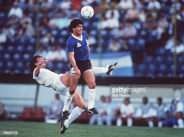 World Cup Finals Second Phase Puebla Mexico 16th June Argentina 1 v Uruguay 0 Argentina's Diego Maradona outjumps Uruguayan defender Nelson Gutierrez