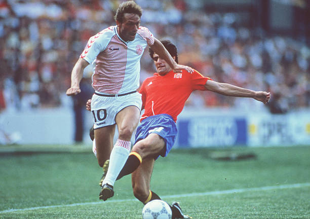 World Cup Finals, Second Phase, Queretaro, Mexico, 18th June Spain 5 v Denmark 1, Denmark's Preben Elkjaer is challenged for the ball by Spain's...