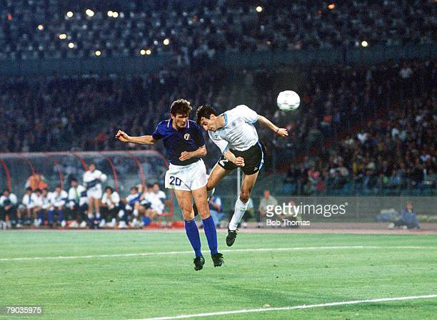World Cup Finals Second Phase Rome Italy 25th June Italy 2 v Uruguay 0 Italy's Aldo Serena beats Uruguay's Nelson Gutierrez in the air to head the...