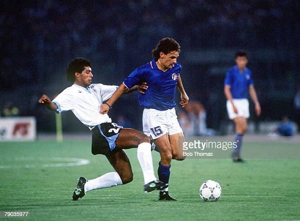 World Cup Finals Second Phase Rome Italy 25th June Italy 2 v Uruguay 0 Italy's Roberto Baggio is challenged for the ball by Uruguay's Ruben Pereira