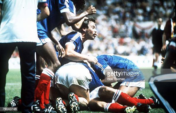 World Cup Finals, Semi-Final, Seville, Spain, 8th July West Germany 3 v France 3, , French players bury Alain Giresse having scored their third goal