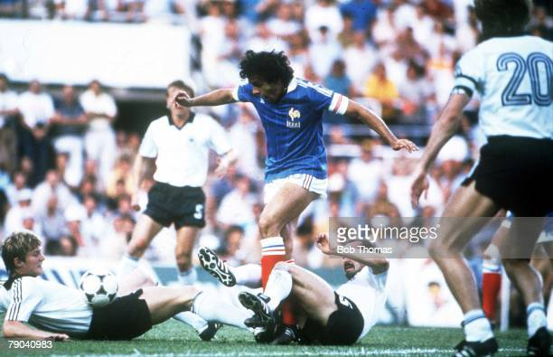 World Cup Finals SemiFinal Seville Spain 8th July West Germany 3 v France 3 France's Michel Platini is tackled by West Germany's Karl Heinz Foerster...