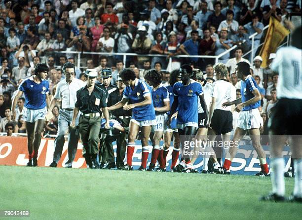 World Cup Finals SemiFinal Seville Spain 8th July West Germany 3 v France 3 France's Patrick Battiston is carried off the field on a stretcher after...