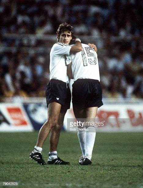 World Cup Finals SemiFinal Seville Spain 8th July West Germany 3 v France 3 West Germany's Pierre Littbarski consoles teammate Uli Stielike after he...