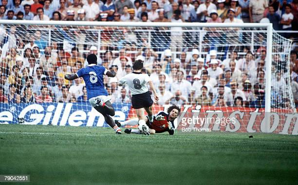 World Cup Finals, Semi-Final, Seville, Spain, 8th July West Germany 3 v France 3, , France's goalkeeper Jean Luc Ettori saves at the feet of West...