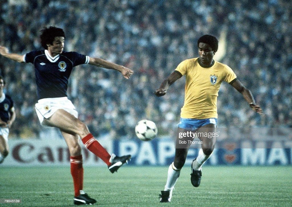 1982 World Cup Finals. Seville, Spain. 18th June, 1982. Brazil 4 v Scotland 1. Scotland's Alan Hansen clears past Brazil's Serginho. : News Photo