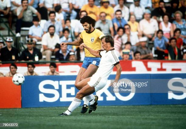 World Cup Finals Seville Spain 23rd June Brazil 4 v New Zealand 0 Brazil's Socrates is tackled by New Zealand's Alan Boath