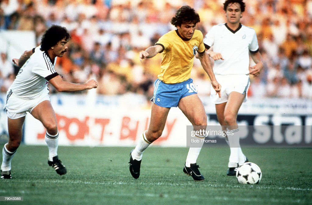 1982 World Cup Finals. Seville, Spain. 23rd June, 1982. Brazil 4 v New Zealand 0. Brazil's Zico is challenged by New Zealand's Adrian Elrick. : News Photo