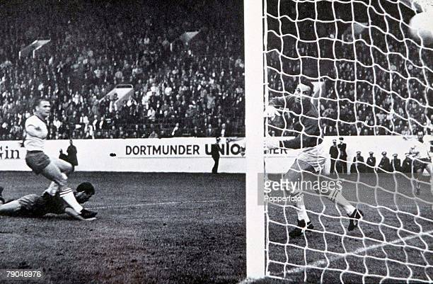 World Cup Finals Sheffield England 15th July Spain 2 v Switzerland 1 Spain's Manuel Sanchis heads in his side's first goal past Swiss goalkeeper Karl...