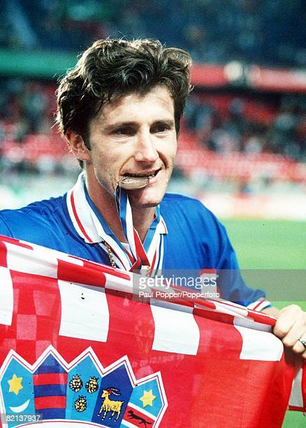 World Cup Finals St Denis France 11th JULY 1998 Third Place PlayOff Croatia 2 v Holland 1 Croatia's Davor Suker bites his Third place medal after the...
