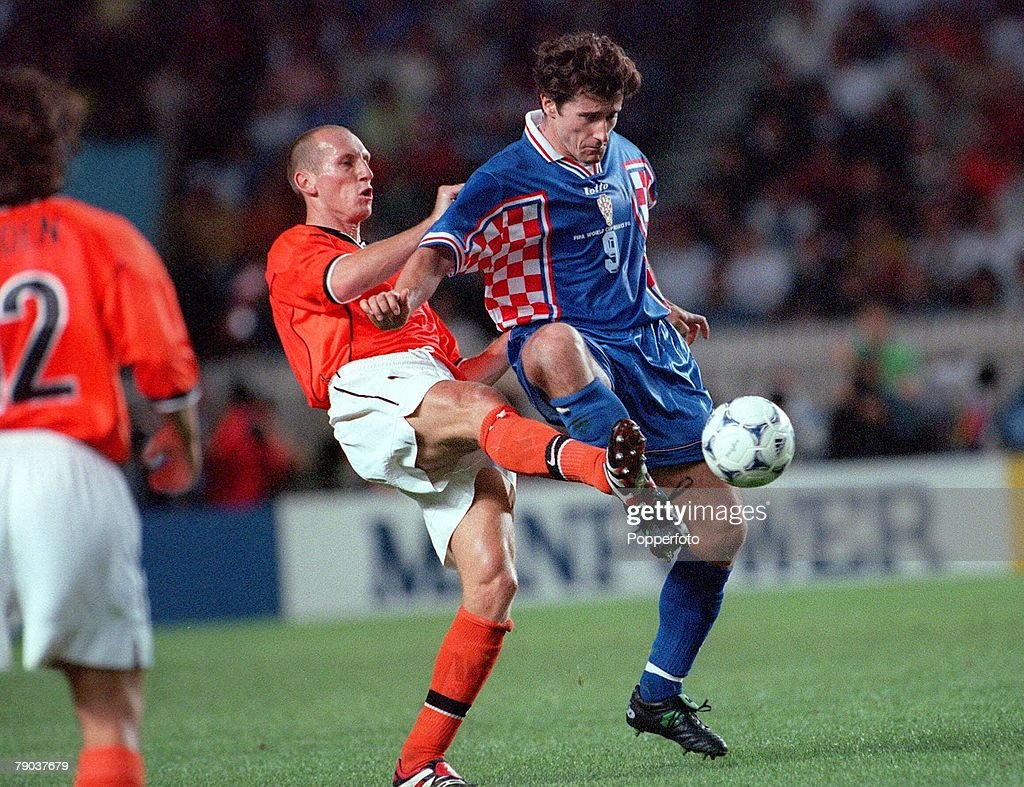1998 World Cup Finals. St. Denis, France. 11th July, 1998. Third Place Play-Off. Croatia 2 v Holland 1. Jaap Stam of Holland tackles Croatia's Davor Suker from behind. : News Photo