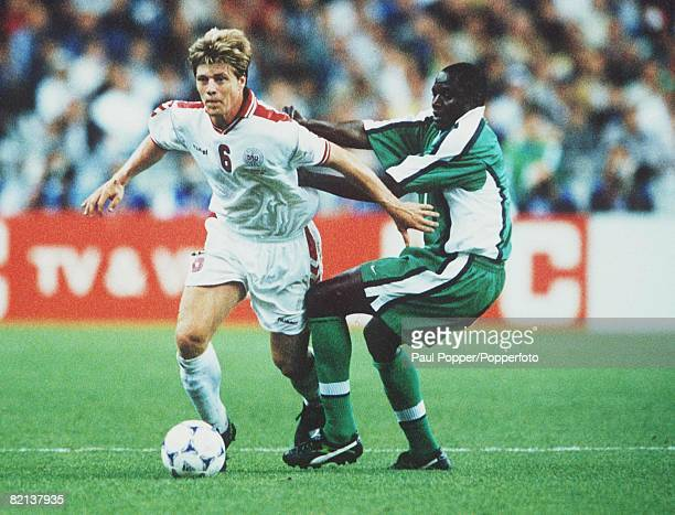 World Cup Finals St Denis France 28th JUNE 1998 Denmark 4 v Nigeria 1 Denmark's Thomas Helveg challenged by Nigeria's Rasheed Yekini