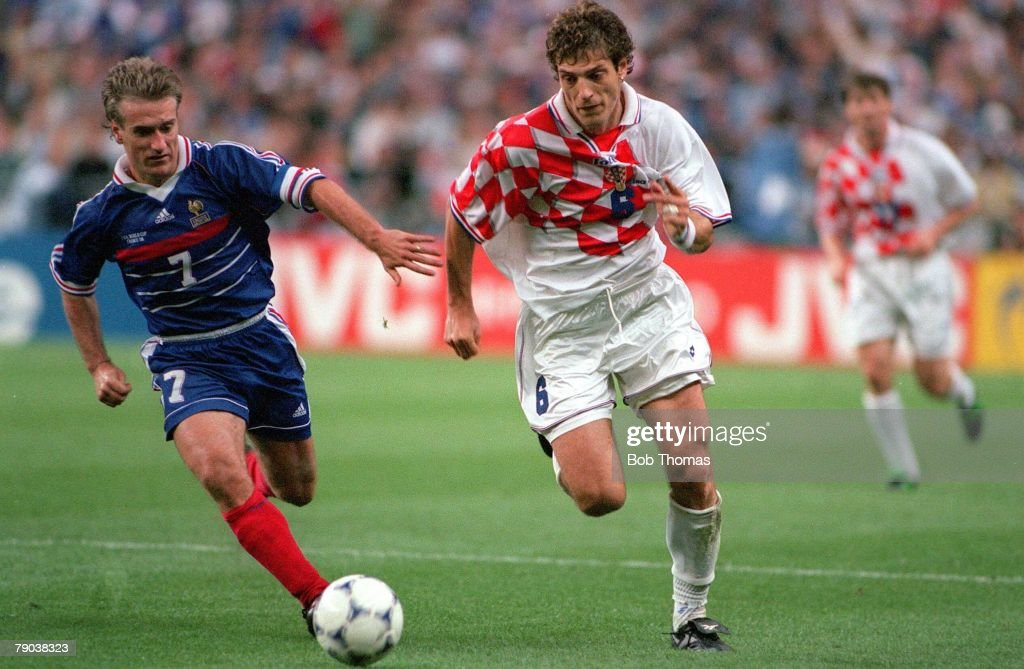 1998 World Cup Finals. St. Denis, France. Semi-Final. 8th July, 1998. France 2 v Croatia 1. Croatia's Slaven Bilic fights for the ball with France's Didier Deschamps. : News Photo