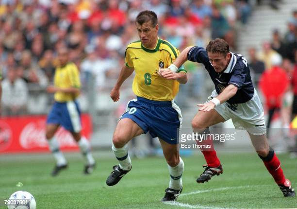 World Cup Finals, St Denis, Paris, 10th June Brazil 2 v Scotland 1, Brazilian captain Dunga fights for the ball with Scotland's Kevin Gallacher