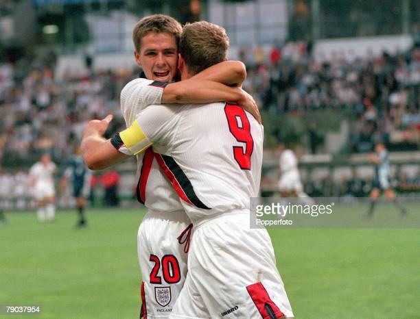 World Cup Finals St Etienne France 30th June England 2 v Argentina 2 England's Michael Owen hugs Alan Shearer after Shearer scored England's first...