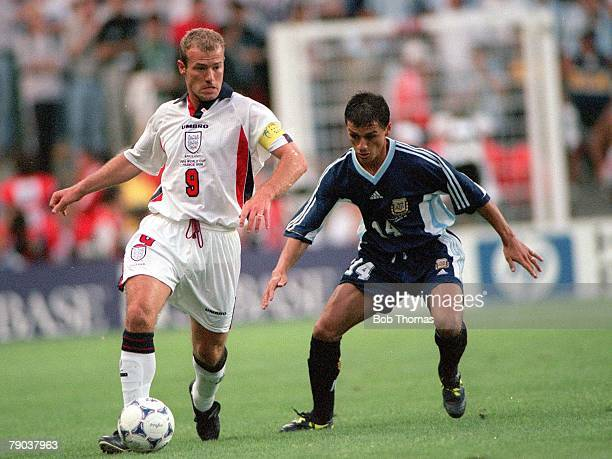 World Cup Finals St Etienne France 30th June England 2 v Argentina 2 England's Alan Shearer closely watched by Argentina's Nelson Vivas