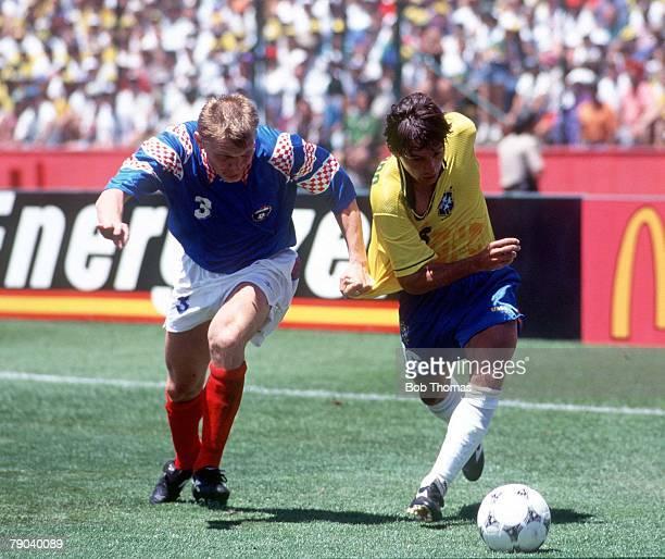 World Cup Finals Stanford USA 20th June Brazil 2 v Russia 0 Brazil's Leonardo with Russia's Gorlukovitch