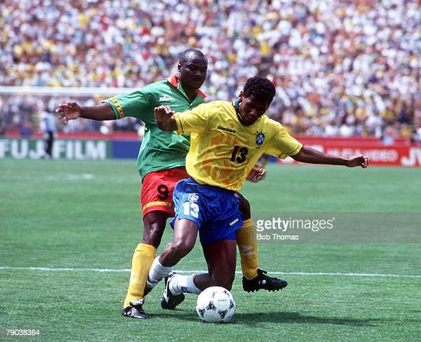 World Cup Finals Stanford USA 24th June Brazil 3 v Cameroon 0 Brazil's Aldair with Cameroon's Roger Milla