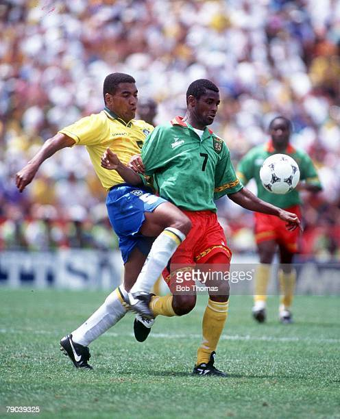 World Cup Finals Stanford USA 24th June Brazil 3 v Cameroon 0 Cameroon's Omam Biyick with Brazil's Mauro Silva