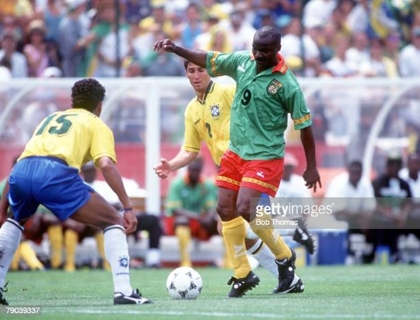 World Cup Finals Stanford USA 24th June Brazil 3 v Cameroon 0 Cameroon's Roger Milla faced by a Brazilian defender