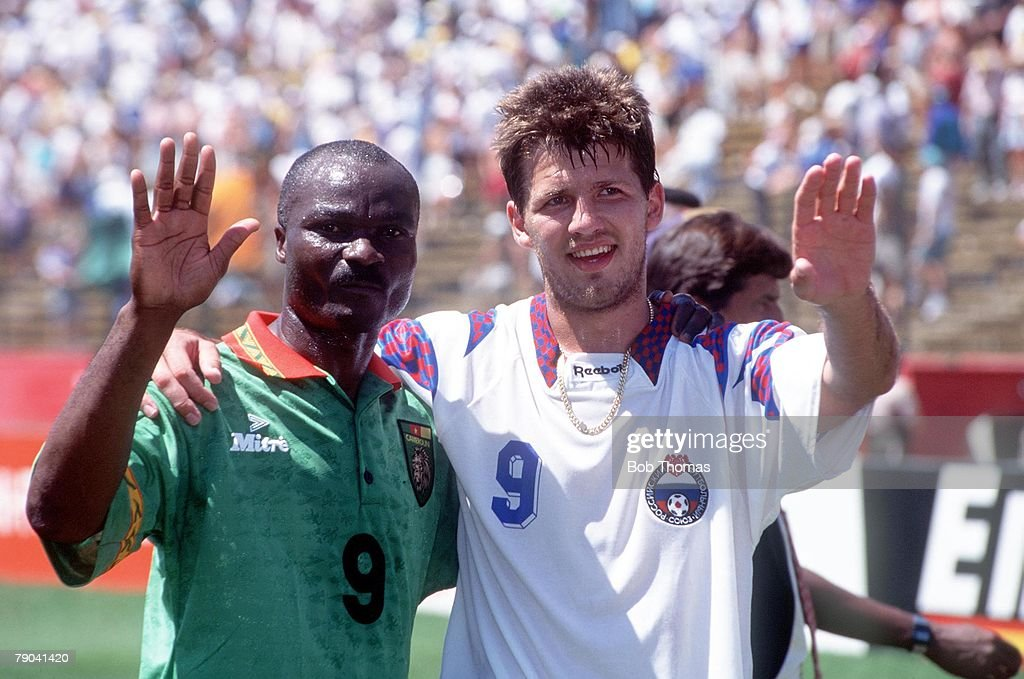 1994 World Cup Finals. Stanford, USA. 28th June 1994. Russia 6 v Cameroon 1. Russian top goalscorer of thetournament Salenko with the tournament's oldest player Roger Milla after the match : News Photo