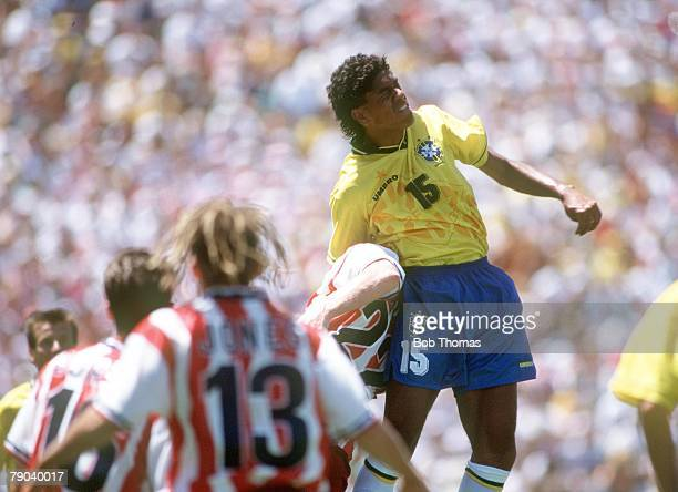 World Cup Finals Stanford USA 4th July Brazil 1 v USA 0 Brazil's Marcio Santos jumps for a high ball during the match