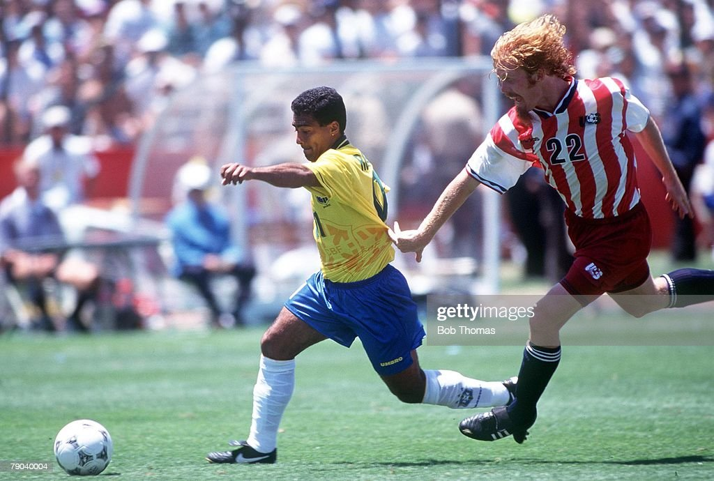 1994 World Cup Finals. Stanford, USA. 4th July, 1994. Brazil 1 v USA 0. Brazil's Romario gets away from USA's Alexei Lalas : News Photo