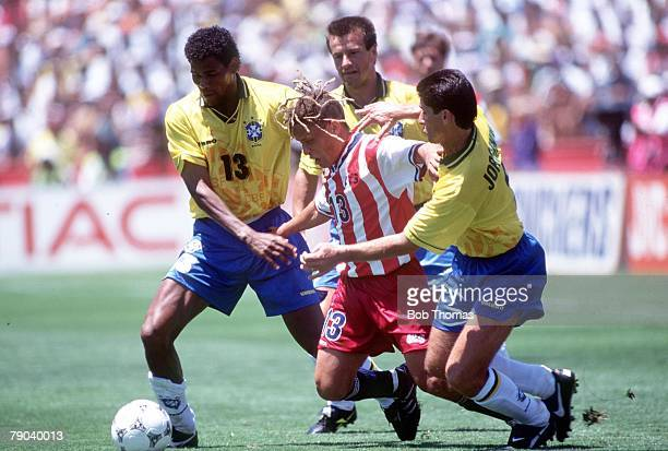 World Cup Finals, Stanford, USA, 4th July Brazil 1 v USA 0, USA's Cobi Jones is surrounded by Brazilian defenders Aldair , Dunga and Jorghino during...