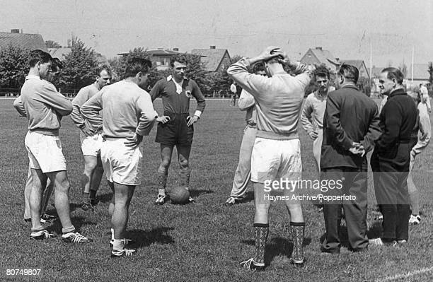 World Cup Finals Sweden German International coach Sepp Herberger talks to his players during a training session